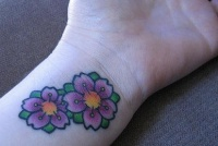Two coloured flowers small tattoo
